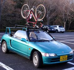 My car:Honda Beat and My bike.