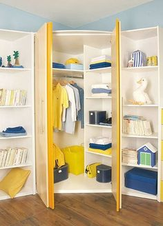 corner wardrobe Great idea for a bedroom with small closet..extra clothes storage flanked by book and toy storage.