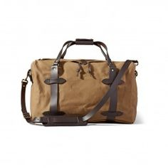 4aef5257bea7 Discover the Filson Medium Duffle Bag. Rain-resistant Rugged Twill and  durable Bridle Leather combine in this durable duffle bag. Discover the travel  bag ...