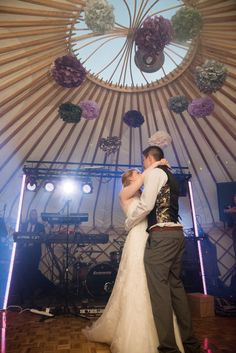 First dance in Yorkshire Yurt 3 aka the dance yurt, decorated with handmade paper pom poms -  Photo by Ruth Mitchell Photography
