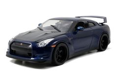 """Brian's 2009 Nissan GTR R35 blue 1:18 scale diecast model car from """"The Fast And The Furious"""" movie by Jada. Get it now at GeekingBad for $79.95 with free shipping."""
