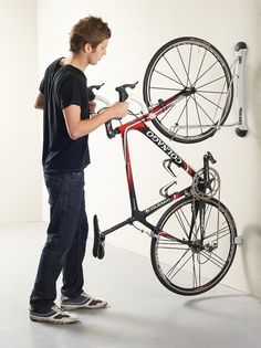 Steady Rack Bike Storage Rack - front tyre rolls onto rack and lifts bike off floor at the same time Rack Velo, Indoor Bike Rack, Best Bike Rack, Diy Bike Rack, Bike Hanger, Bike Storage Office, Bike Storage Garage Wall, Bike Storage Apartment, Bike Storage Rack