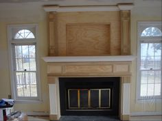 Yes!! Hide those black boxes!! Mantel with component storage.... It  was designed and built to the homeowner's specifications, in that he wanted a mantel that would conceal all his equipment.  As you can see the fluted pilaster legs conceal storage for dvd's, while the actual mantel has room for the components and center channel speaker. We re-framed the empty space behind and above the fireplace to make room. ...