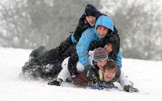 Edward Greville sent in this photo of youngsters playing in the snow on Streatley Hill in Berkshire - England