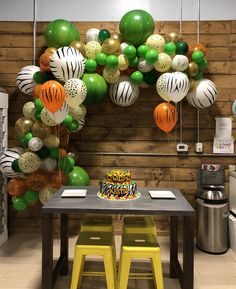 Pretty sure all of these balloons are available at spotlight Safari Theme Birthday, Jungle Theme Parties, Wild One Birthday Party, 1st Boy Birthday, Jungle Party, Safari Party Decorations, Safari Centerpieces, Jungle Balloons, Lion King Birthday