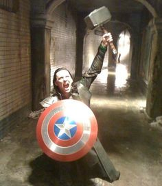 Tom Hiddleston having some fun on set....