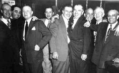 """Cleveland Mafia members and their attorneys, circa 1960, after an apparent courtroom victory. Second from left is Angelo """"Big Ange"""" Lonardo. Third is Shondor Birns."""