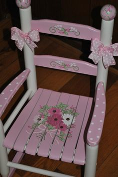 """MAKE A LITTLE GIRLS NURSERY SOMETHING SPECIAL  Hand painted childrens rocking chair. Solid wood construction with hand painted wooden finials and ribbon trim included.  ALL ROCKING CHAIRS CAN BE """"PERSONALIZED"""" AT NO EXTRA CHARGE.  All paints and finishes used are lead-free and non-toxic, and the solid hardwood construction is designed to last. Rocking chairs are completely finished with several coats a durable polyurethane finish making it easy to clean.  PLEASE BE ADVISED -- as indicated in…"""