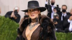 Cowgirl fashion is making its way to the mainstream, and Jennifer Lopez's look at the Met Gala is the latest example. The Met Gala is considered to be fashion's biggest night of the year, and JLo's ensemble garnered plenty of attention! Cowgirl Style, Cowgirl Fashion, Met Gala Red Carpet, Celebrity Closets, Western Look, Big Night, Plunging Neckline, Jennifer Lopez, Riding Helmets