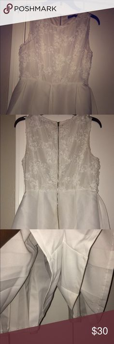 Cute Mini Romper White Mini Romper, worn only ONCE, a slight little stain by the bottom zipper which you can see in the picture, but im sure it can come out, I think it came from sitting down on a wood chair, but really cute, a little short, but doesn't reveal too much, perfect for a Wedding or Lunch Date to impress!!! Other