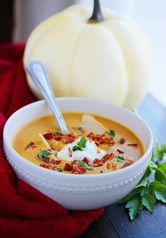 """Creamy Pumpkin Soup Recipe from The Comfort of Cooking. """"I'll just be right out with it – this pumpkin soup is the best soup I've ever made! It's creamy, velvety smooth and delicious with a pile of tasty toppings like chopped bacon, sour cream, herbs and a few fresh shavings of Parmesan cheese. Or, heck, leave out the toppings and enjoy it as-is. You'll love it!"""""""
