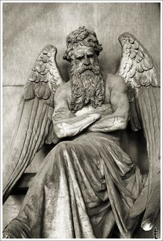 grumpy looking angel --Staglieno Cemetery ~ Genoa, Italy