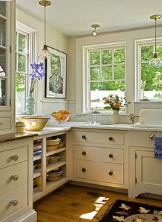 Interesting details in the lower cabinets.....open shelving and drawers instead of doors.....makes for more horizontal lines instead of verticals....could make a small kitchen seem larger.longer...