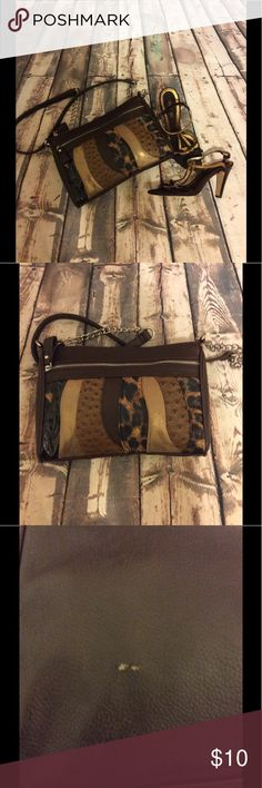 "Carlos Santana Purse Carlos Santana Purse with zip closures( please see photo of the small scratch on the back -clean inside-cheetah/ brown& gold -approx 10.5""W x 7.5""L with 44"" length strap Carlos Santana Bags Crossbody Bags"