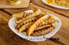 The Slow Roasted Italian: Seasoned Grilled Fries - Seasoned Grilled Fries spiced with Chile de Arbol & grilled to perfection. With a firm crispy exterior these fries are the best for dipping!