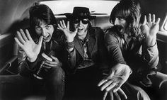Cory Wells, left, with the other members of Three Dog Night, Joe Schermie  and Chuck Negron in the backseat of a car