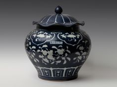 Xuande period, Ming dynasty  A Blue Ground Undergraze White  Decorated 'Pomegranate' Jar And Cover.  Xuande six-character mark