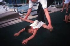 Torture at the Xiantao sports school in Hubei province, China. For five-and-six-year-olds the joints of the boys are bent beyond their limits in order to create a permanent joint stretch. If this is not done at an early age, certain gymnastic moves are not possible when they are older.
