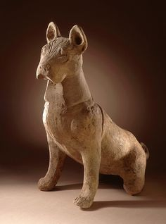 An ancient Chinese funerary sculpture of a dog, made to guard and repel malign influences symbolically. (LACMA)