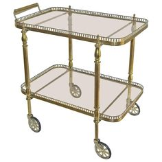 French Neoclassic Vintage Brass Bar Cart   From a unique collection of antique and modern carts and bar carts at https://www.1stdibs.com/furniture/tables/bar-carts/