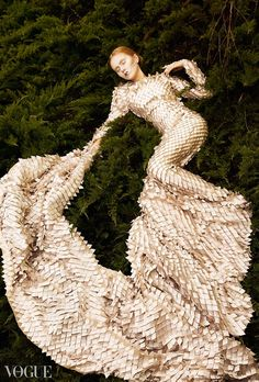 Vogue Italia gold dress in grass