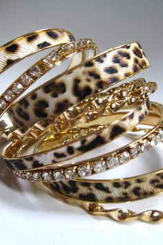 Leopard bangles... Hermans Style  Follow our web pages to the address:  Facebook  - Lo Stile è la veste del pensiero                    - Hermans street Clothes                    - Hermans Photo Instagram - Hermans Style  Thank you   Shoe shoes scarpe bags bag borse fashion chic luxury street style moda donna moda uomo wedding planner  hair man Hair woman  outfit time watch nail  print photo foto fotografia cartoline Photography tattoo