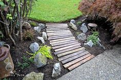 make a pallet wood walkway for your garden, diy, flowers, gardening, landscapes, pallet, repurposing upcycling, Placing the planks in a slight curve as well as random alignment made for a slightly more interesting take
