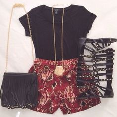 Get ready for summer with pattern shorts and gladiator sandals! This red, black, and gold combination really makes a statement.