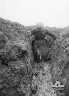 Trench Warfare - Hell on Earth, Australian soldier makes his way through a flooded trench, western front - 1917