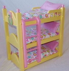 This listing is for our new handmade triple bunk bed painted in our new color sunshine yellow created by Keating Woodcraft. Treat your little princess to this unique triple bunk bed. This gift will become a cherished heirloom to be handed down from generation to generation. Our beautiful new bunk bed is perfect for the American Girl Doll, baby doll, teddy bears and all 18 inch dolls. We have left plenty of space in between each bed to allow for easy placing of your dolls. Our bed is…