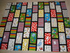 Dr Seuss quilt-use copies of book jackets and have each class vote on a favorite and write a quote from that book on the placed between covers