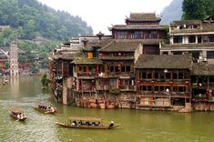 boats and wooden houses at Phoenix Town - the one the four most attractive small towns in China, next to Tuojiang , Amazing Places On Earth, Beautiful Places To Travel, Places Around The World, Travel Around The World, Cool Places To Visit, Beautiful World, Around The Worlds, Villas, Outdoor Life