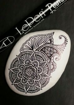 ••• Alaska Art Stones ••• Another freehand design! Permanent LePen on latex painted Alaska river rock.