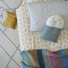 Spot floral golden duvet cover, check pillow caes, crochet wool blanket and teal house cushion all by Camomile London Teal House, Crochet Wool, Mini Muffins, Wool Blanket, Designer Collection, Kids Rooms, Duvet Covers, Toddler Bed, Bedding