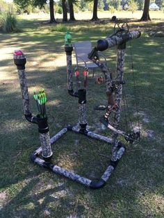"""DIY 2"""" PVC Bowstand with drink holders & 3"""" PVC arrow quivers to hold more arrows."""