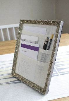 organizer = Frame   fabric glued in layers to make pockets . Do this for the kitchen !! to organize mail and bills as they come in!