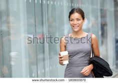 Business woman walking drinking coffee. Lawyer professional or similar walking…