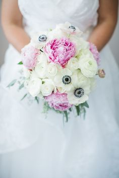 Peonies and anemones, two quintessential spring blooms, take center stage in this bouquet designed by Lavish Events by Christina. Seeded eucalyptus and ranunculus complete the stunning look.
