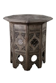 Oak octagon coffee table  Enjoy coffee in style with this wonderful coffee table. It is made from Syrian carved wood and also has a beautiful mother of pearl detail. It is octagon in shape and stands at approximately 47cm high with a width of 46cm.