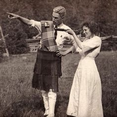Happy #tartanday! This photo shows an unknown woman looking through a telescope while the man beside her is wearing a kilt and spats.  #vintage #oshawamuseum #Oshawa #tartan #kilt