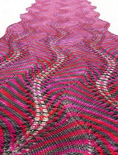Shetland Ruffles is a two color feather and fan stripe shawl/wrap with sinuous curves.