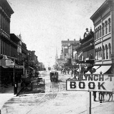 1890s view of Whitehall Street (now Peachtree Street) at Alabama Street.