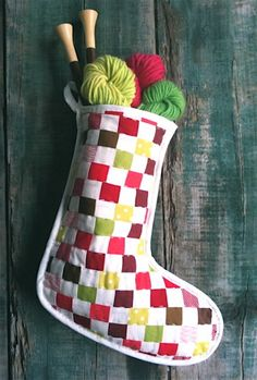 I love this strip pieced stocking!  credit: The Purl Bee [http://www.purlbee.com/strip-pieced-christmas-stockin/]