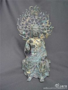A Buddhist statue unearthed from Longhua Temple in Shandong Province.  Longhua Temple was initially built during the time between the Southern and Northern Dynasties (386 - 589) and the Sui Dynasty (581 - 618).  It was a huge monastery, with a total site area around 3 million sqm, that is 4 times larger than the Forbidden City in Beijing, the biggest royal palace in today's world.  Unfortunately the entire structure was destroyed in 1948.