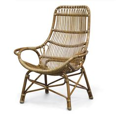 Palecek Retro Rattan High Back Lounge Chair. Pole rattan frame and legs with pencil pole rattan details in a medium brown finish. Accented with natural rattan peel bindings. Available only as shown.