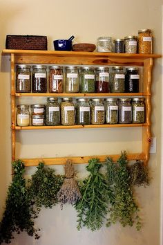 The Home Apothecary... essential oils and mortar and pestle on top shelf. Drying rack on bottom. Love it!