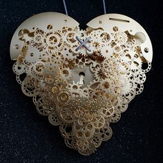 """The heart is such a complicated thing, both physically as it beats to keep us alive, and emotionally in matters of love. These complex pieces are symbolic of the intricate structure and layers of delicate balance associated with a heart. Developed by designer Frank Tjepkema, or Tjep., the two bodies of work, Clockwork Love Gold and Clockwork Love Paper, are described as """"A jewelry collection evenly and consistently combining a great multitude of graphic elements in a multitude of layers."""""""