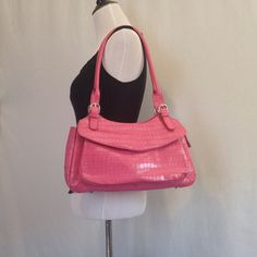 """🌺Maxx NY Large Handbag🌺 Pink croc embossed leather bag with zipper closure. Front side has a flap pocket with a magnetic snap. Back side has large zip pocket. Interior is lined with pretty paisley print with 3 slip pockets and 1 zip pocket. Silver hardware with feet and adjustable buckled straps. 11.5"""" strap drop. Excellent used condition except for 1 tiny pen mark about 1 centimeter long on top flap part outside. See picture 4. $40 Maxx NY Bags Shoulder Bags"""