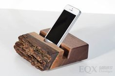 This wooden iPhone holder / charging station is definitely an object that you will use every day. Whether this live edge stand is on your kitchen counter, on your working desk or your nightstand, you will definitely add a modern and warm touch to the ambience of your home. Specifications: - Groove inclination of 15 degrees. - Accepts all types of Smartphone / iPhone. Up to 5/8 (1,59cm) thick. - Cavity to hide your charging cable under the docking station. - Accessible Home b...
