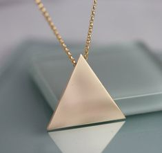 Inspired by Stevie Nicks, I created this Triangle Pendant Necklace. This is an equilateral triangle with 1 1/8 sides. The bale is attached on the back for a smooth seamless effect. Choose from 14k gold filled or solid sterling silver. I am pairing this pendant with a sturdy rolo style gold filled chain in a variety of lengths to suit your needs. Wear alone as a statement or layer with other necklaces.  Please leave a note in the message to seller upon checkout to indicate if you want shi...